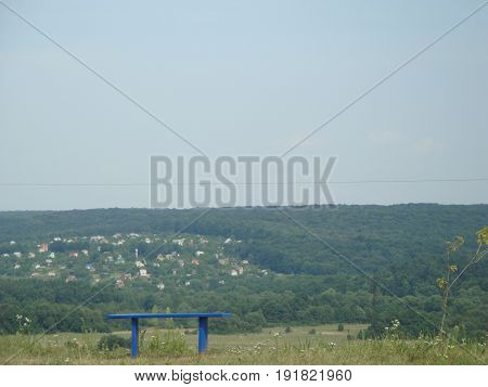 Bench to relax or solitude, and beautiful landscape on the background