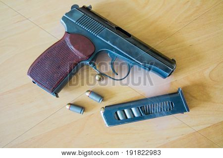 russian 9mm handgun Makarov on the table with holster, belt and empty pistol holder