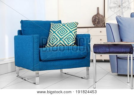New armchair in modern room interior. Minimalism concept