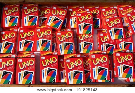 El Raso, Alicante, Spain - July 2, 2016: Many sealed uno cards are in new packages on the trade tray. Mercadillo de Campo de Guardamar.