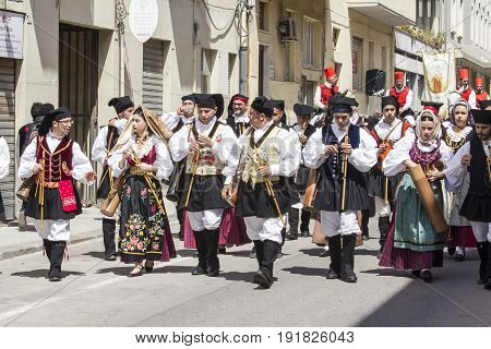 CAGLIARI, ITALY - MAY 1, 2017: 361 Religious procession of Sant'Efisio - Launeddas musicians marching in Sardinian traditional costume - Sardinia