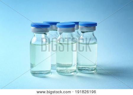 Medical ampules on colour background. Vaccination concept