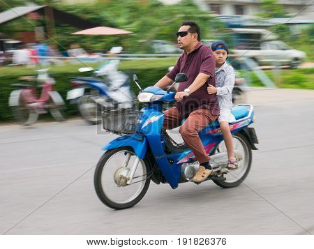 Chiang Rai, Thailand - May 10, 2017 : Unidentified People  Is Riding A Motorbike Unsafe Without Wear