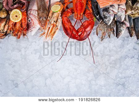 Fresh tasty seafood served on old wooden table. Top view. Close-up.