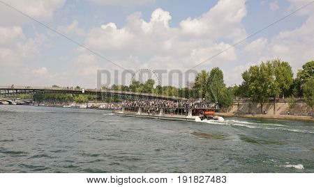 ParisFrance- April 29 2017: Ship with tourists on board sailed under the bridge Leopold Sedar Senghor