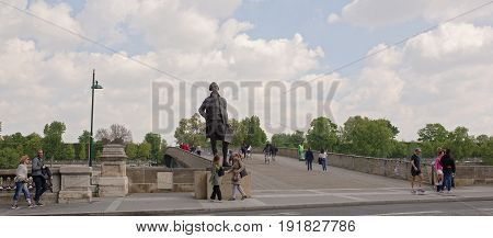 ParisFrance- April 29 2017: Monument to Jefferson at Bridge Leopold Sedar Senghor. Citizens go and ride their bicycles on their own business