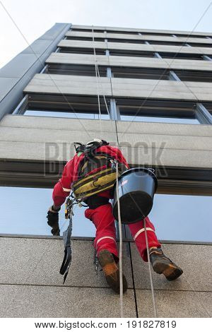 High altitude window alpinist washer hanging on the rope