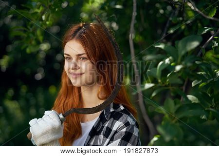 Woman with mower, woman in vegetable garden, woman working.