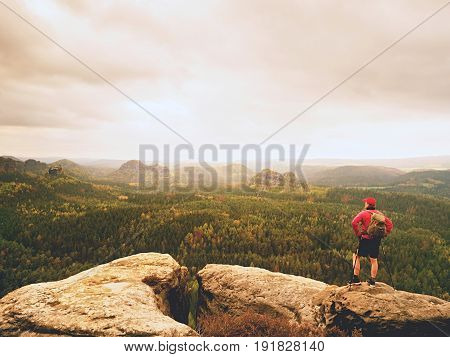 Tourist In Red Black Sportswear, Green Backpack On View Point Watch Landscape.