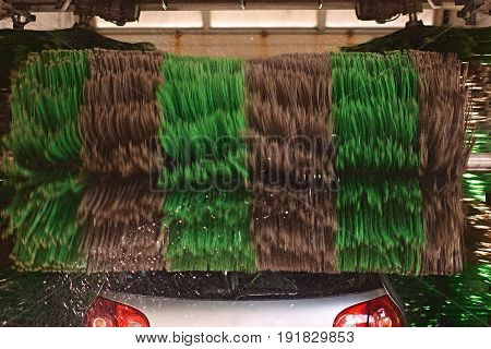 Automatic striped roller brush in action at service station