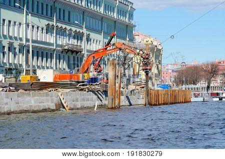 SAINT PETERSBURG RUSSIA - MAY 3 2017: Reconstruction of Fontanka River embankment St. Petersburg Russia