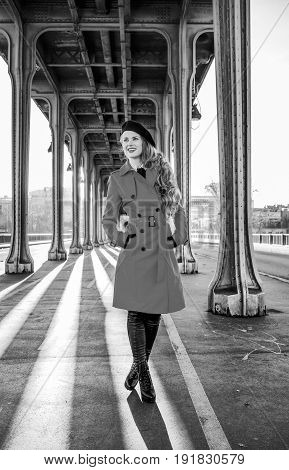 Tourist Woman On Pont De Bir-hakeim Bridge Looking Into Distance