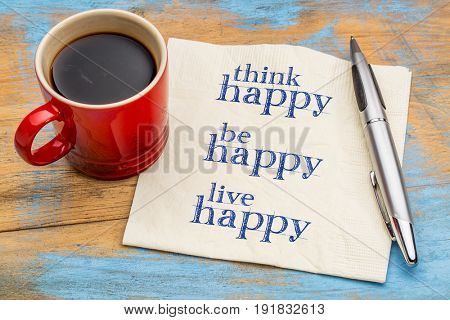 think, be, live happy - handwriting on a napkin with a cup of espresso coffee