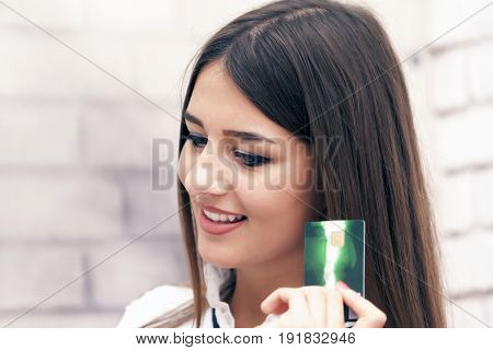 Young Beautiful Smiling Woman  Buys Online