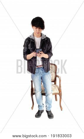 An Asian man looking at his cell phone and is happy what he is seeing isolated for white background.