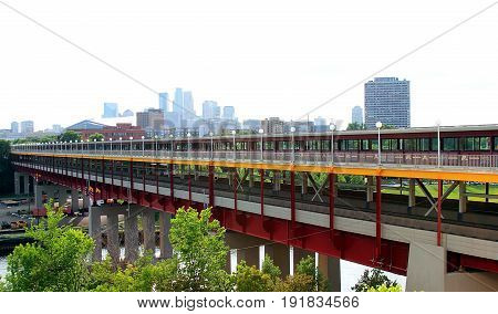 Minneapolis, Minnesota - July 8,2015: Converging footbridge stretching across University of Minnesota campus.