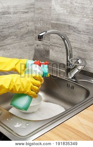 Hands In Gloves Washing Tableware With Sponge And Detergent