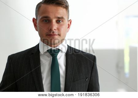 Handsome Smiling Man In Suit And Tie Stand In Office