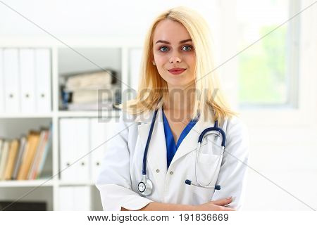 Beautiful Smiling Female Doctor Stand In Office Portrait
