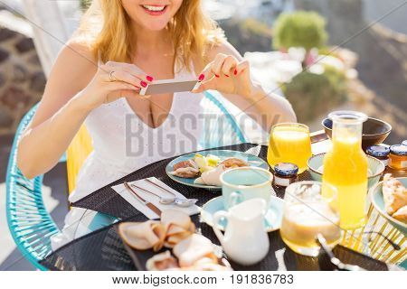 Girl taking picture of food with her phone