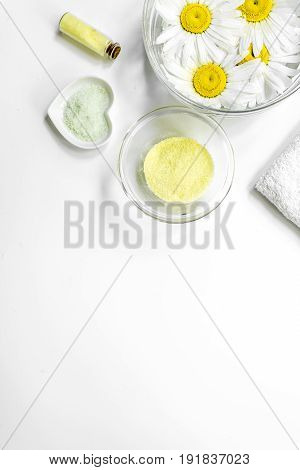Spa composition with salt, chamomile and towel copyspase top view white background.