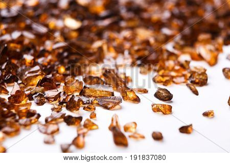 Brown Amber stones on white background. Pile of natural gems, free space for text. Beauty, jewelry concept