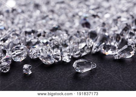 Jewelry, luxury. Beautiful diamonds on black background, free space. Pile of crystals close-up. Treasure concept