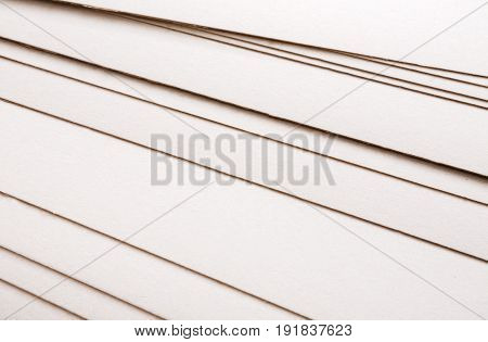 Paper sheets stack close up, abstract background. Blank white pages fan, printing backdrop, copy space
