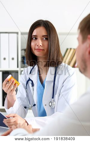 Beautiful Smiling Female Doctor Hold In Arms Jar Of Pills