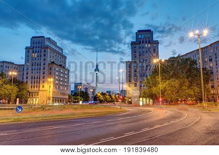 The Strausberger Platz in Berlin with the Television Tower at dusk