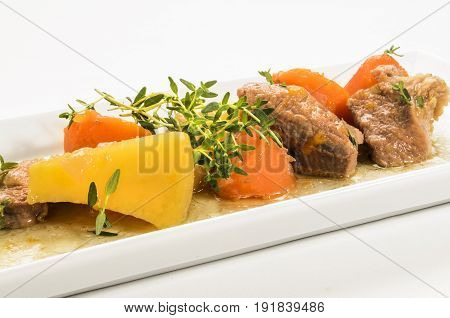 fine dinning traditonal irish stew with fresh thyme on a plate