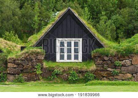 Icelandic turf house with grass on the roof. Traditional home of Iceland. Museum in the Skogar village