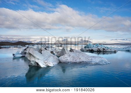 Landscape of Iceland, Europe. Iceberg in the glacial lagoon, located in the southeastern part of the island, near the glacier Vatnajokull. Tourist attraction. Cloudy day of the month June