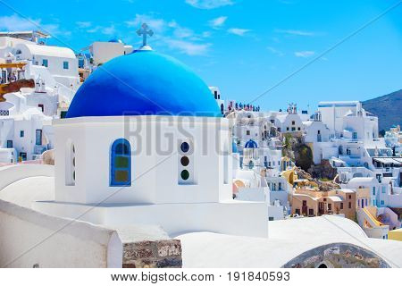 One of many churches in Santorini with blue roof