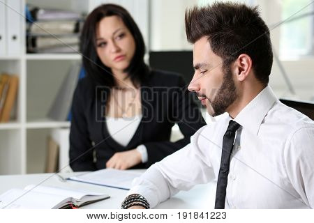 Beautiful smiling woman talk to male visitor in office portrait. Problem discussion white collar at workspace loan mortgage investment development job offer gossip and relationship concept