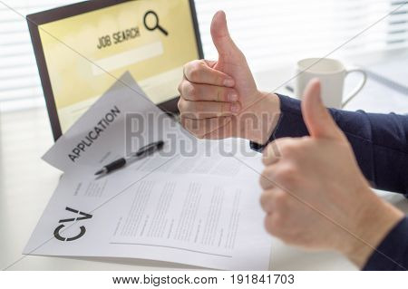 Thumbs up for job search. Applicant with positive attitude. Happy job seeker showing two hand gestures. Cheerful man pleased with finding work. Hired or motivated job seeker. Successful employment.