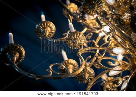 Beautiful golden grand lamp with candles in church. Sweden Scandinavia Europe.