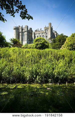 Arundel castle in lush green surroundings on sunny day