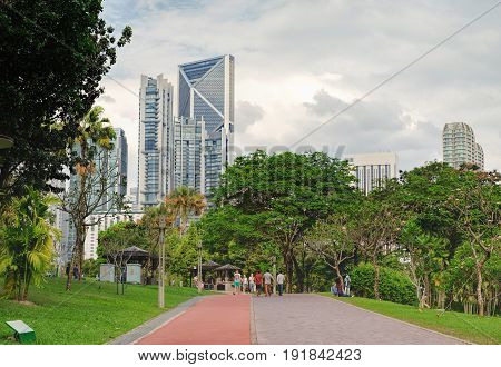 Kuala Lumpur, Malaysia - February 10 2016: KLCC Park is a public park in Kuala Lumpur, Malaysia. Wading pool is in the middle of the park in front of Suria KLCC mall and Twin Towers