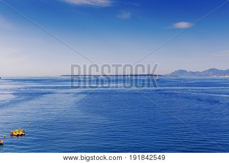 JUAN LES PINS FRANCE - September 23rd 2016: Blue Mediterranean landscape on a warm serene summer day shot in Juan Les Pins on the French Riviera