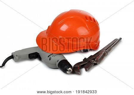 Work tool and helmet on white background