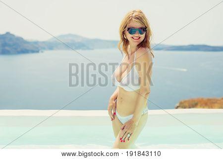 Sexy woman in white bikini. Retro vintage style filter.