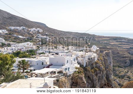 The city of Chora on Folegandros island Greece placed on the edge of a steep cliff.