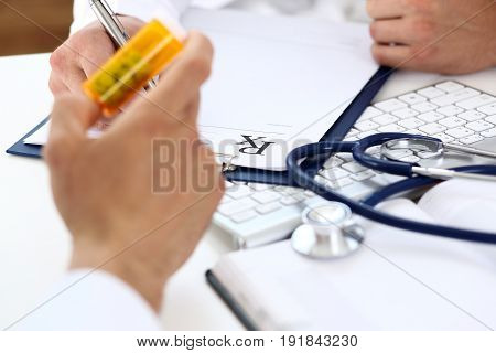 Male Medicine Doctor Write Prescription At Worktable