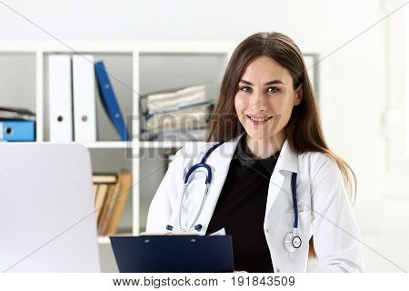 Beautiful Smiling Female Doctor Hold Clipboard Pad
