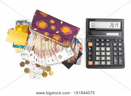 Calculator cash coins credit cards and purse on a white background.