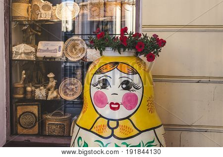 Matryoshka with a flower bed on the head