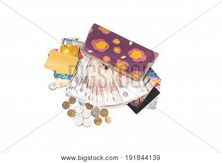 Cash coins credit cards and purse on a white background.