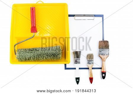 A folder with clip and painting supplies.