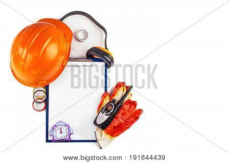 Building Facilities clock radio and a folder with a clip.